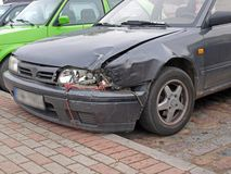 Traffic accident. Damaged car after the collision on the parking place Royalty Free Stock Image