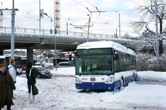 Traffic accident. Dangerous traffic accident with public transport in Riga, Latvia on February 2, 2010. Trolleybus stuck in snow and blocked driving on slippery Stock Photography