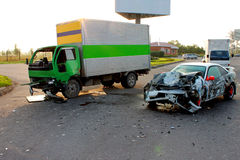 Traffic accident. The car at high speed collided with a small truck Royalty Free Stock Photo