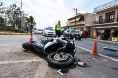 Traffic accident between a car and a motorcycle Royalty Free Stock Photos
