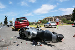 Traffic accident between a car and a motorcycle stock photos
