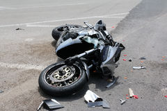 Traffic accident between a car and a motorcycle. Argolida, Greece - May 15, 2016: traffic accident between a car and a motorcycle large displacement on country royalty free stock photos