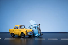 Traffic Accident. Classic fifties scale model toy cars accident on the road stock images