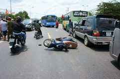 Traffic accident, crashed car, motorbike. DONG NAI, VIET NAM- MAY 1: Traffic accident on highway 20, crowded of Vietnamese people on street, car crash with Stock Photos