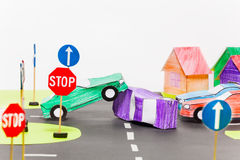 Traffic accident on a crossings at the toy city. Picture of traffic accident of two handmade paper cars on a crossings at the toy city, with copy-space Royalty Free Stock Image