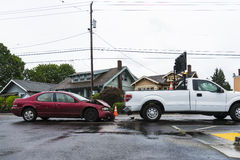 Traffic accident involving passenger car and the signal truck Stock Image