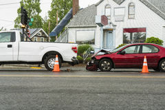 Traffic accident between passenger car and a pickup truck. Traffic accident in the rain between a passenger car in the pickup truck Royalty Free Stock Photos