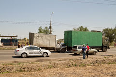 Traffic accident on the road involving old commercial trucks Stock Images