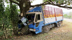Traffic accident,truck hit tree on intercity road. Day time stock video footage