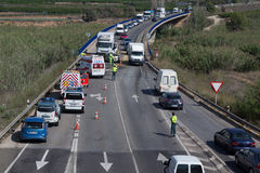 Traffic Accident. VALENCIA, SPAIN - SEPTEMBER 30, 2014: Police directing traffic around an traffic accident where a small car collided head on with a truck. In Royalty Free Stock Images