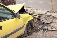 Traffic accident. Yellow crashed car Royalty Free Stock Photos