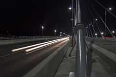 Traffic across the bridge at nightfall 3 Royalty Free Stock Photo