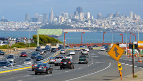 Traffic aginst San Francisco skylin California. SAN FRANCISCO - MAY 19 2015:Traffic aginst San Francisco skyline.SF has the 2cond-worst congestion in the United royalty free stock photos