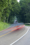 Traffic Ahead. Country road with cars royalty free stock photo