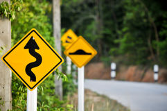 Traffic alerts downhill slope. Reduce speed and use a lower gear Royalty Free Stock Photography