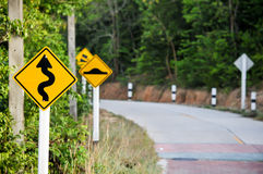 Traffic alerts downhill slope. Reduce speed and use a lower gear Royalty Free Stock Photos