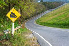 Traffic alerts downhill slope. Reduce speed and use a lower gear. Drive with caution royalty free stock photography