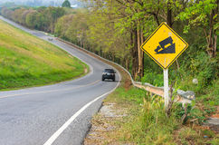 Traffic alerts downhill slope. Reduce speed and use a lower gear. Drive with caution royalty free stock photos