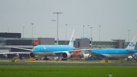 Traffic at Amsterdam airport. AMSTERDAM, THE NETHERLANDS - JULY 25, 2017: Boeing 777 Royal Dutch Airlines KLM taxiing on apron, Shiphol Airport, Amsterdam stock footage