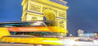 Traffic around Triumph Arc at night in Paris - France.  Stock Images