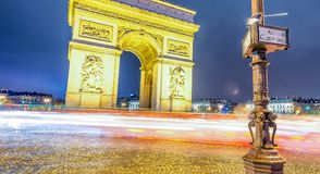 Traffic around Triumph Arc at night in Paris - France.  Royalty Free Stock Images