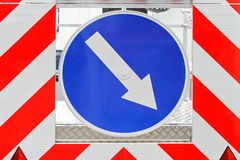 Traffic arrow. Direction arrow sign signaling traffic diversion Royalty Free Stock Photo