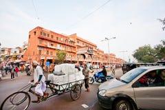 Traffic on the asian street full of cars, rickshaws Stock Photo