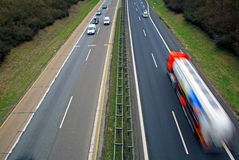 Traffic on Autobahn. A cargo truck and cars on the German autobahn Royalty Free Stock Photos