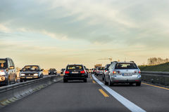Traffic on the autobahn during sunset Royalty Free Stock Photo