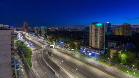 Traffic on avenue Marshal Zhukov timelapse in Moscow at night. Traffic on avenue Marshal Zhukov timelapse aerial top view in Moscow at night from rooftop. Road stock footage