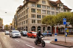 Traffic on Bahnhofstrasse in Zurich city center. Zurich, Switzerland - September 2, 2016: Traffic on Bahnhofstrasse in Zurich city center, Switzerland. People on royalty free stock images