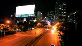 Traffic in Bangkok, Thailand. Advertising board. Traffic on the road in Bangkok city stock video footage
