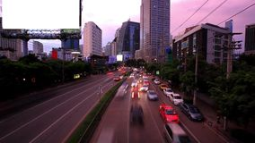 Traffic in Bangkok, Thailand. Advertising board. Traffic on the road. Timelapse speed up. Thailand stock footage