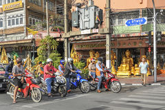 Traffic in Bangkok, Thailand. Unidentified people on a motorbike during the morning rush hour on July, 2013 in Bangkok, Thailand. The use of motorbikes as Stock Photos