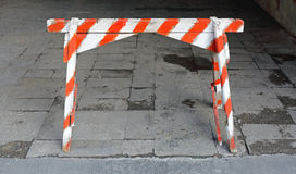 Traffic Barricade. Old Wooden Traffic Barricade Striped Barrier Sign royalty free stock photos