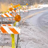 Traffic barricades with lights and caution tapes royalty free stock photo