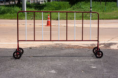 Traffic barrier. Steel wheel with red and white traffic barrier Royalty Free Stock Images