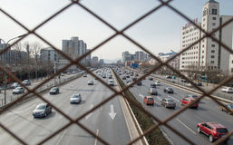 Traffic behind barbed wire. When Beijing's traffic every rush hour, vehicles are particularly,This photo was taken on March 9, 2014,which is separated by Stock Photos