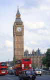 Traffic by Big Ben. Traditional cabs and double decker buses on the road.London. UK Royalty Free Stock Photography