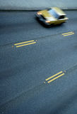 Traffic Blur. Three clear lanes with one blurry moving car royalty free stock image