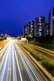Traffic with blur light through city Royalty Free Stock Photos