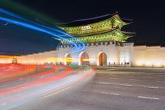 Traffic blurs past Gyeongbokgung palace at night in Seoul, South Royalty Free Stock Photos