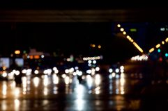 Traffic with bokeh effect. At sunset a rainy day Royalty Free Stock Image