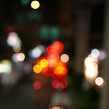 Traffic bokeh at night on the blurred background Stock Image