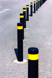 Traffic bollards. Detail on a paved road - Repetition concept Royalty Free Stock Photography