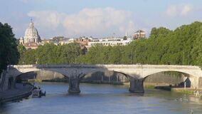Traffic on bridge across river Tiber, Rome cityscape with dome of Vatican church stock video