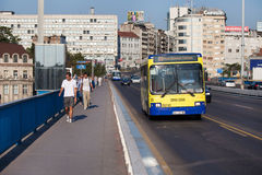 Traffic on bridge. BELGRADE, SERBIA - AUG 15: Pedestrians and bus crossing the bridge on August 15, 2012 in Belgrade, Serbia. City public transport consists of Stock Images