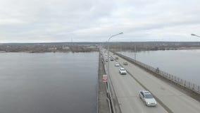 Traffic on the bridge on the Kama River. Autumn, aerial. Big bridge on the Kama River in the city of Perm. Autumn. Span of the bridge stock video