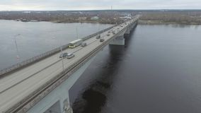 Traffic on the bridge on the Kama River. Autumn, aerial. stock video