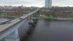 Traffic on the bridge on the Kama River. Autumn, aerial. Big bridge on the Kama River in the city of Perm. Autumn. Span of the bridge stock video footage